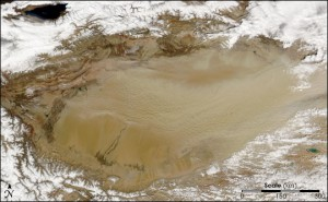 NASA Earth Observatory Boyle and Sean Birkel of the University of Maine are working to model climate change in China's desert-filled Tarim Basin, seen here via satellite. This dust bowl stretches across nearly 260,000 square kilometers, hemmed in by mountains and the Tibet Plateau.