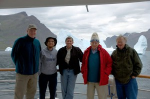 Photo by Philip Walsh, courtesy of the Comer Science and Education Foundation  Key climate change scientists joined Gary Comer (red jacket) on his yacht the Turmoil for a research trip to Greenland in 2005. From left, George Denton of the University of Maine, Richard Alley of Pennylvania State University, Philip Conkling of the Island Institute, Comer and Wallace Broecker of Columbia University's Lamont-Doherty Earth Observatory.
