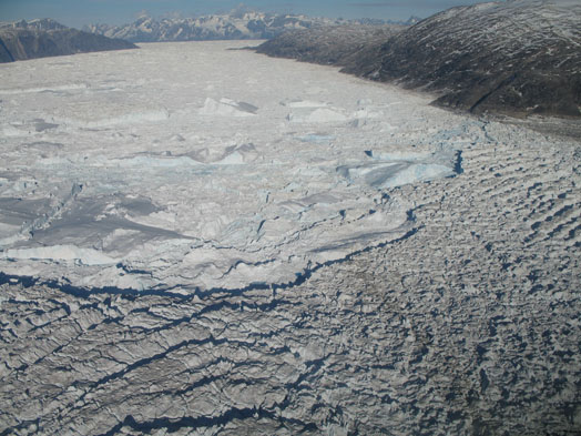 Courtesy of Meredith Nettles Calving front of the Helheim Glacier in Greenland. Low tides may be adding to the stress of ice collapsing from glaciers such as the Helheim.