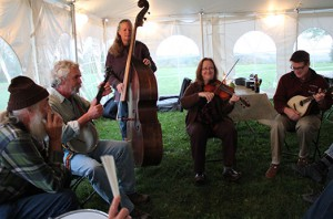 Medill photo Jeffrey Severinghaus joins of the band at the picnic following the Comer Conference. Several scientists make music at the party.