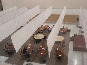 Gretchen Roecker/MEDILL To provide a space for scientists from around the world to present and display their research at the Comer Conference, an airplane hangar is transformed with tarps and tables.