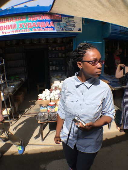 Destiny Washington at an open air market in Ulaanbaatar where the group purchased cookware and other supplies for the trip. (Kevin Stark/Medill)