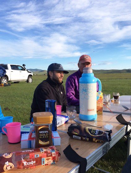 Kevin Stark and Scott Travis having breakfast on the first morning outside of Ulaanbaatar. Instant coffee and biscuits are a staple of the mornings on the road. (Destiny Washington/Gary Comer College Prep)