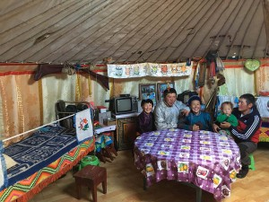 Ganna's (second from left) family gathers in their home, a traditional ger made of felt and wood. They are clothed in deels, wool garments common in pastoralist communities here.