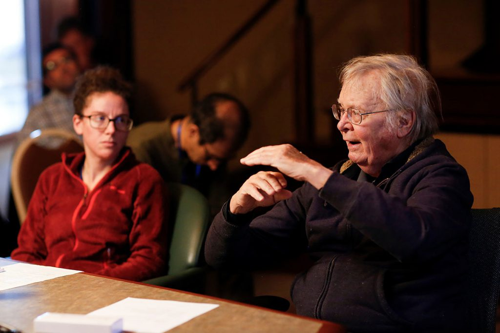 Wally Broecker speaks to another scientist
