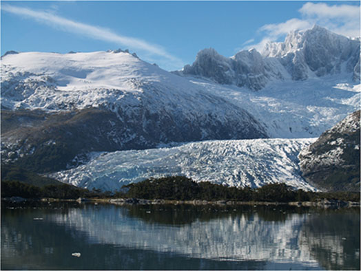 Courtesy of Brenda Hall The Kalv Glacier in Cordillera Darwin at Bahia Pia, Chile, one of the research bases for Hall's team. The Tierra del Fuego glaciers, like this one, are rapidly disappearing due to human-caused warming.