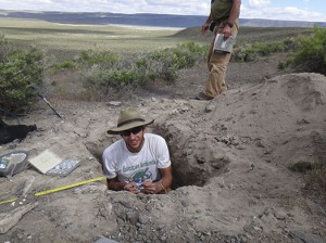 Courtesy of Adam Hudson   Geosciences Ph.D. candidate Adam Hudson, of the University of Arizona, digs up shells for radiocarbon dating from a dried out lake in Oregon. The dating will help reconstruct periods of glaciation when water filled the lake.