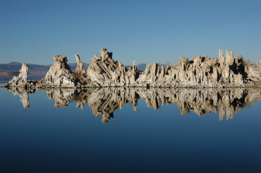 Photo by Scott Stine. Spires of tufa, reflected in the waters of Mono Lake, hold clues to climate changes of the past and future.