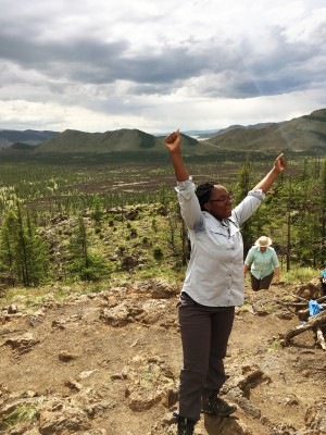 "Gary Comer College Prep's Destiny Washington celebrating at the top of a volcano peak in the Khangai region. ""We've passed a lot of landscapes, you can see how the country is divided,"" Destiny said. (Kevin Stark/Medill)"