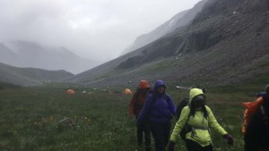 The group leaves camp early in the morning just as rain is descending down the valley (Kevin Stark/Medill).