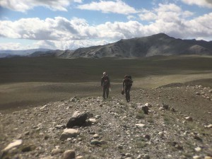 Aaron Putnam and Peter Strand, both of University of Maine, hiking along a glacial moraine on the last day in the field. (Kevin Stark / Medill).