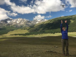 University of Maine graduate student Mariah Radue uses a drone to video landforms left by the glaciers in the Altai Mountains of Mongolia. (Kevin Stark/MEDILL)